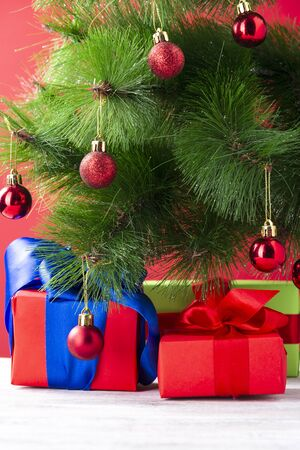 Many christmas gifts under fir-tree close up holiday composition. Stock Photo