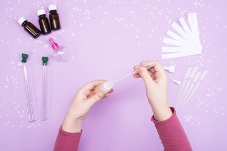 Making perfumes at home. Childrens art project. Childrens hands make perfume.DIY concept. Step by step