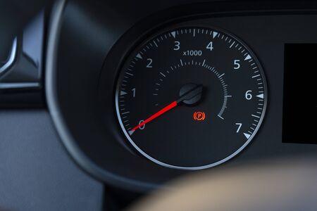 handbrake icon on the dashboard. Modern light car mileage.
