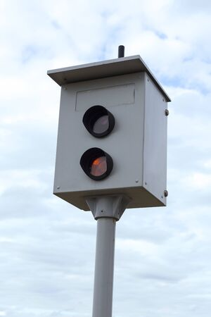 camera monitoring the speed of cars against a blue sky.