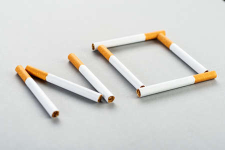 The symbolic form of the word is no. Made from cigarettes on the table. Lies flat, top view. World No Tobacco Day. View from above.