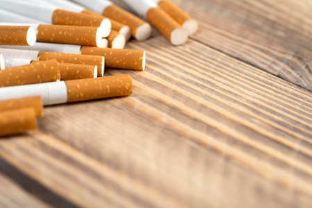 cigarettes on wooden background, close-up of a cigarette with place for text.