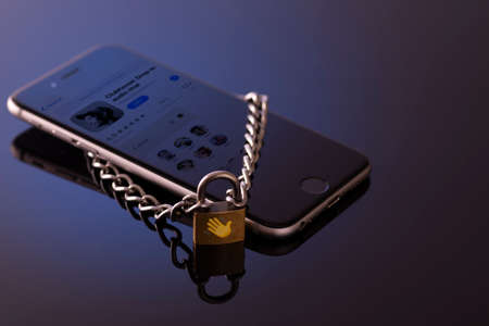Minsk, Belarus - 01 31 2021: Browsing the Clubhouse app on a smartphone, a controversy of 2021 hiding behind the Social app. Lock on the phone as a symbol of a closed application. 新闻类图片