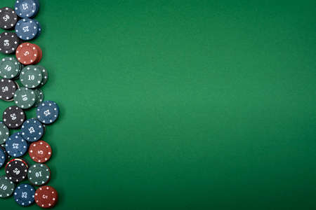 casino chips on green background with place for text.