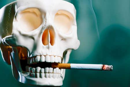 Skull smokes a cigarette, copy space. Smoking kills. Standard-Bild