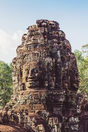 Temple Bayon, Angkor, Cambodia.Face tower at the Bayon Temple. Фото со стока
