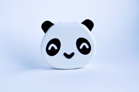 Plastic toy panda bear on white background
