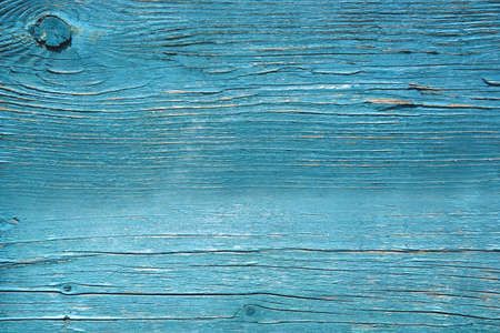 wood textured solid background in blue with knots