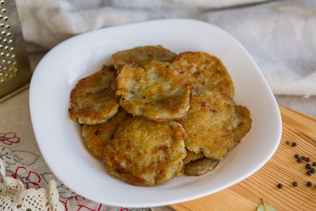 Potato pancakes with sour cream. National Russian dish.