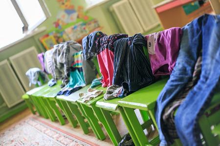 literas: The kidswear hanged on stools in kindergarten in sleepy hour.