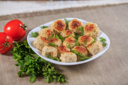 Chicken cutlets with greens on a gray background