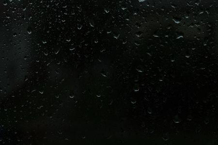 On transparent glass rain drops flow down Reklamní fotografie
