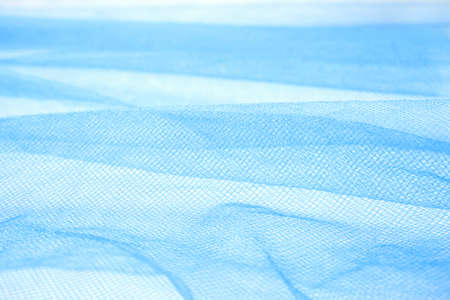 closeup of wavy blue organza fabric. abstract background and texture