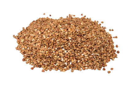 Buckwheat cereal grains isolated on the white background. Pile of buckwheat isolated on white background. Top view. Pandemic