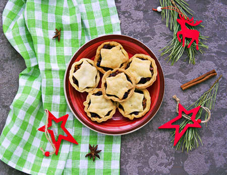 Step-by-step cooking of mince pies traditional British Christmas shortcrust pastry cakes stuffed with dried fruits, nuts and apples. Merry christmas and happy new year concept.