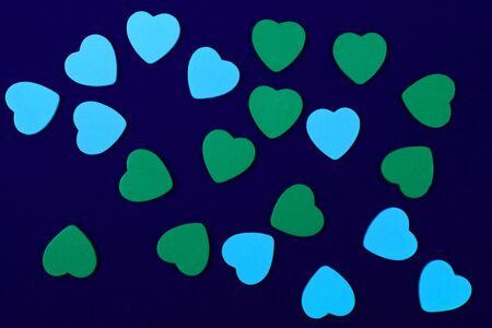 blue and green hearts on dark blue background photo