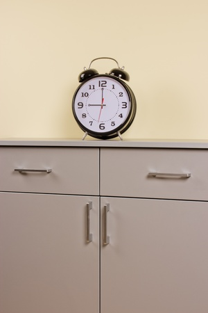 alarm clock on the chest of drawers Stock Photo