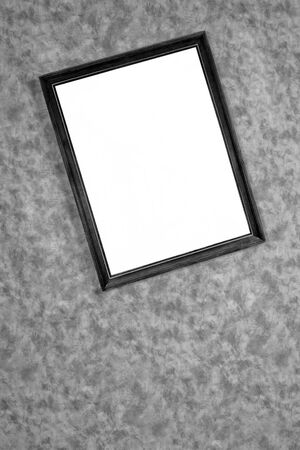 splotchy: old dark framemirror on the wall