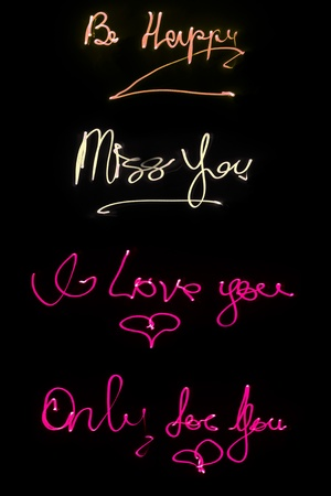 Lighted words on black background Stock Photo