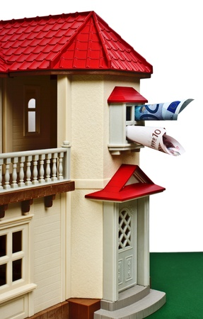 Model house with euro banknotes photo