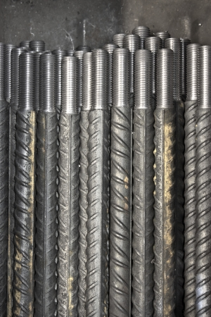 round rods: threaded metal rod, close up of screw thread  Stock Photo
