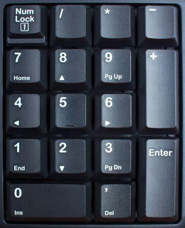 teclado numérico: teclado negro de cerca, las teclas del ordenador en el teclado