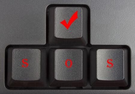 typer: black keyboard close up, computer keys on keyboard, SOS, save our soul Stock Photo