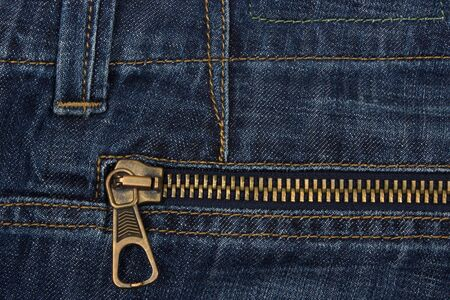 Closeup of zipper in blue jeans , background Stock Photo
