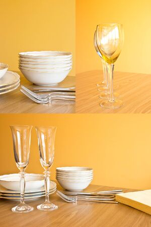 Clean dishes on wooden table on orange background, the set