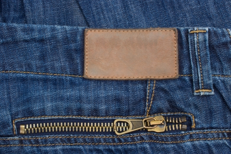 Leather label, front view of denim label, blue jeans and leather label  photo