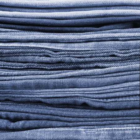 Blue jeans trousers stack closeup
