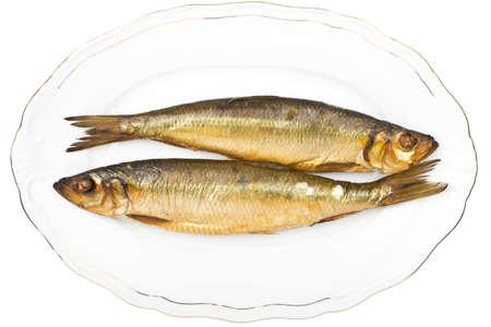 Smoked herrings on white plate Stock Photo - 14295930