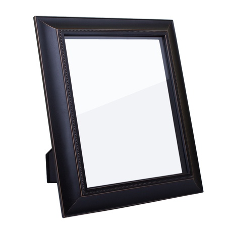 Blank dark wooden picture frame isolated on white background photo