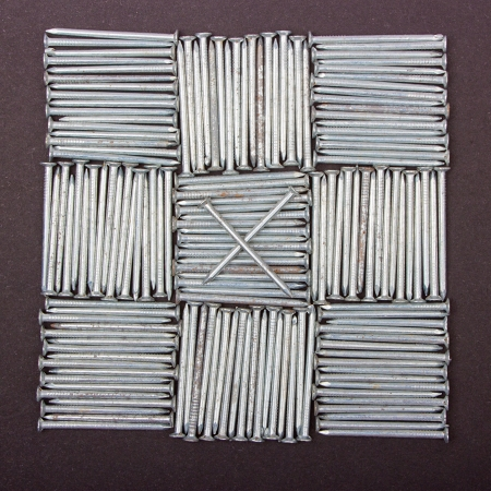 Nails on black background, close up ,background of small iron nails,Tic Tac Toe Game Stock Photo - 14523842
