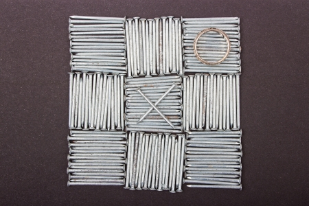 Nails on black background, close up ,background of small iron nails,Tic Tac Toe Game  photo