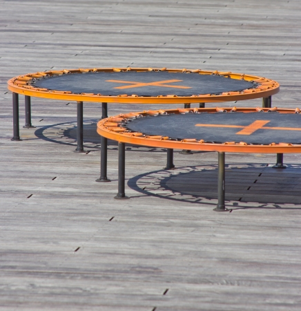 small trampolines on wooden background