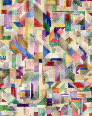 abstract embroidered good by cross-stitch pattern, can be used as background photo