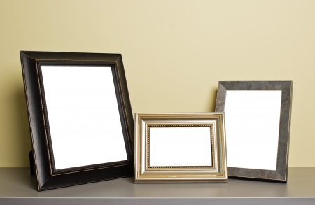 empty photo frames on old table