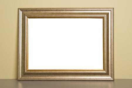 mantel: Cornice d'oro su legno grigio mensola del camino. Archivio Fotografico