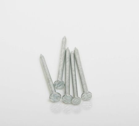 clench: Steel nails on a white background Stock Photo
