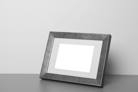 Blank picture frame at the desk photo
