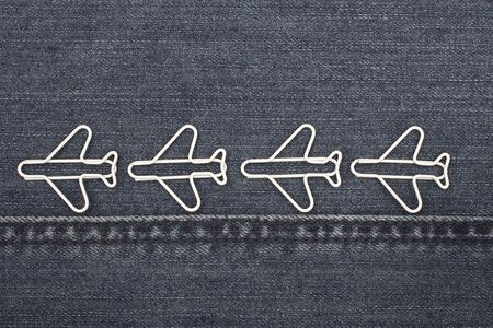 jeans texture, white clips in the form of planes on the jeans texture, Paper Clip with Path  photo