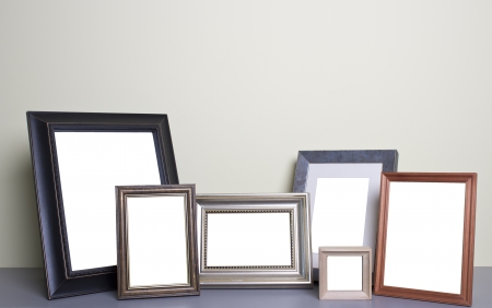 old photo border: blank photo frames on the table