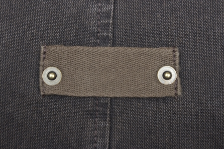 Blank jeans label. Fragment of jeans with pure label for your text. photo
