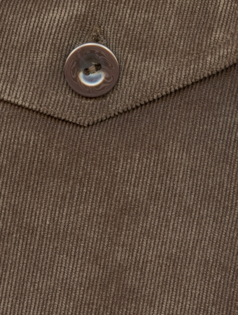 Fragment of pocket, Trouser pocket of brown corduroys.    photo