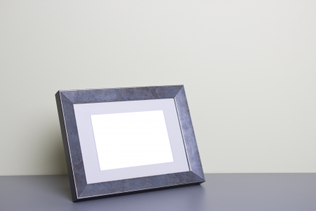 steel frame: Blank picture frame at the desk