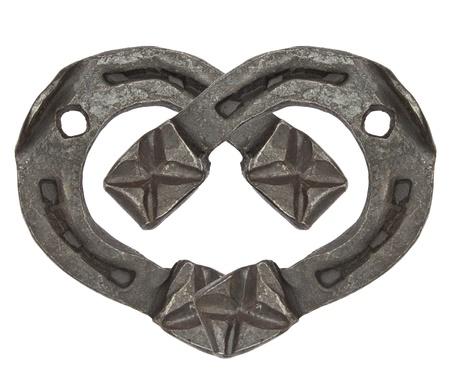 the heart of horseshoes isolated on white background photo