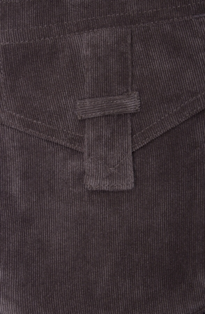 Fragment of jeans with pocket, Trouser pocket of brown corduroys. photo
