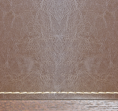 wood and leather background with seam photo