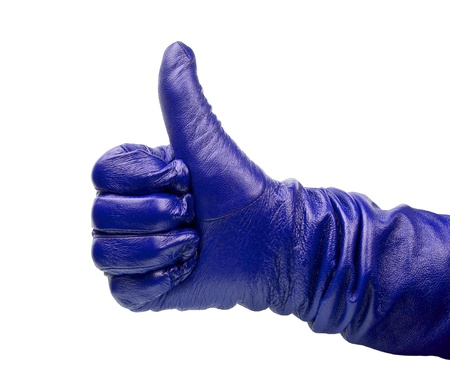 Closeup of hand in blueglove showing thumbs up sign against white background